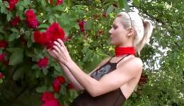 Hot blonde dressed perky and she is exposing her boobs outdoors
