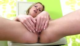 Blonde is rubbing her wet pussy hole and stuffing it with a huge dildo