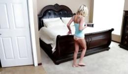 Lonely and sexy young girl is masturbating on a huge bed