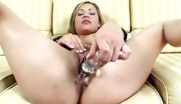 Sassy whore is filling her pussy with a huge dildo and sucking rod